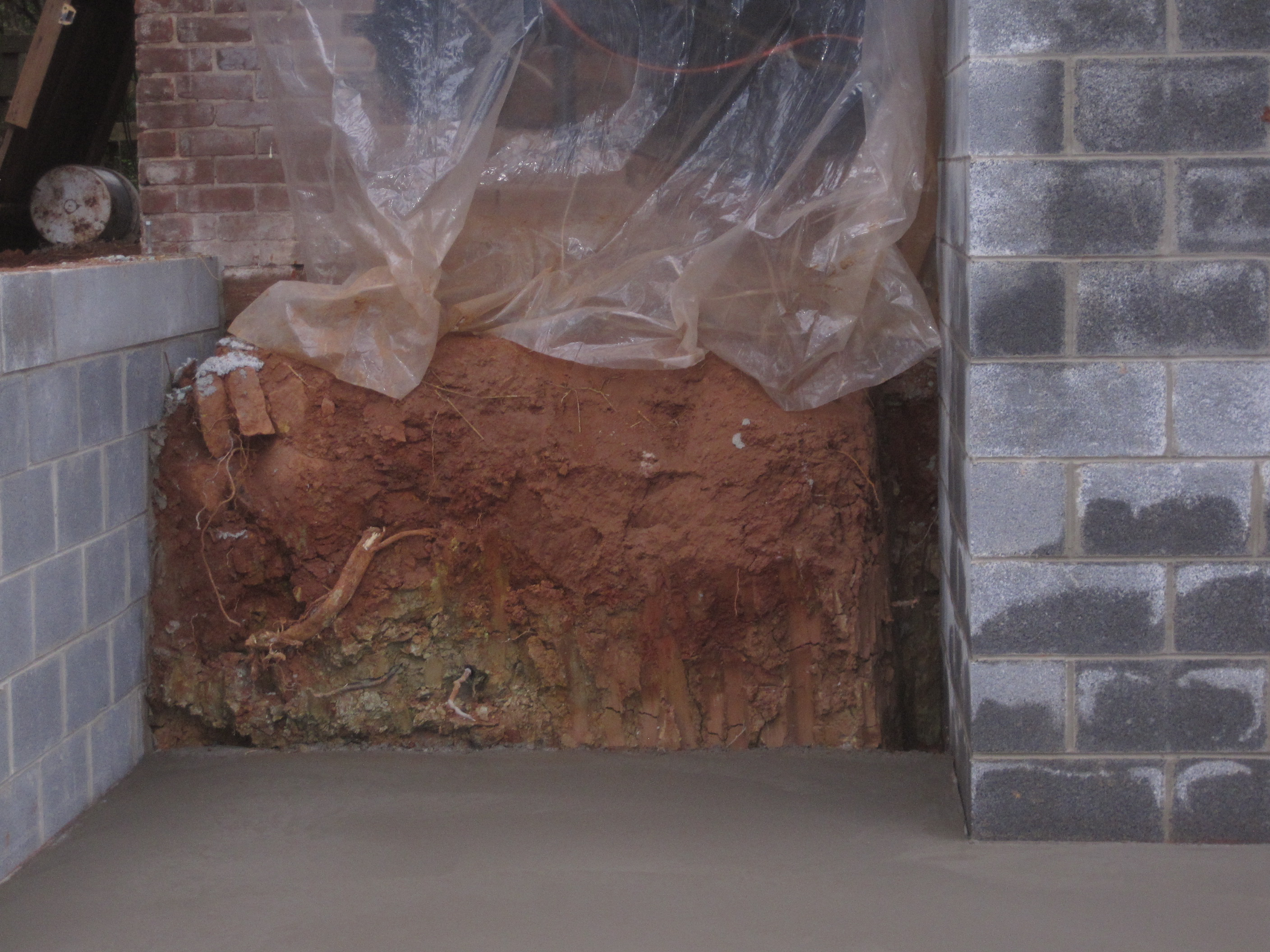 Just another dirt in the wall - Another Fun Feature Is What I Call The Trench Of Doom The Block Walls Were Backfilled With Dirt Along The Outside Walls But The Big New Wall That Supports